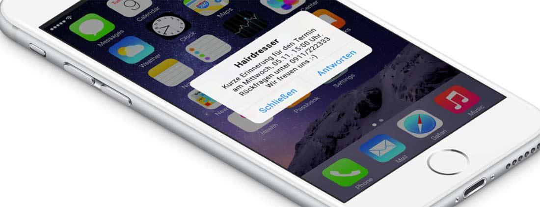 iPhone-Screen mit eingegangener SMS mit Termin-Erinnerung vom Friseur