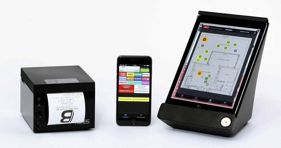 cashpad mit terminal und mobilem endgerät sowie bondrucker